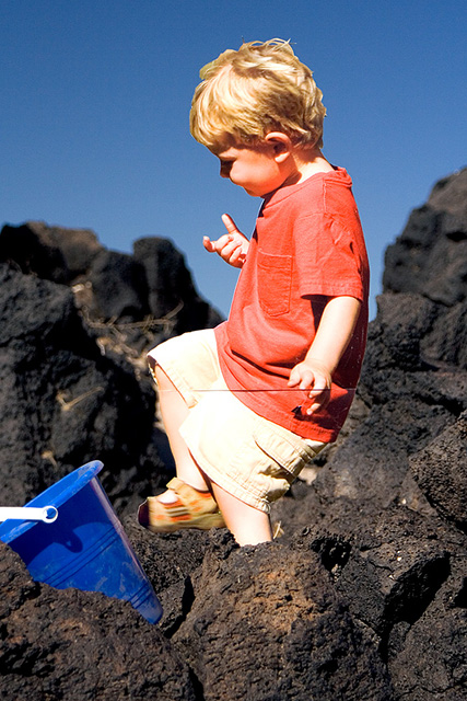 toddler kicking the bucket on top of lava flow