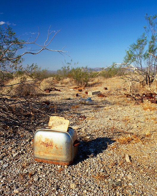 vintage toaster on desert floor
